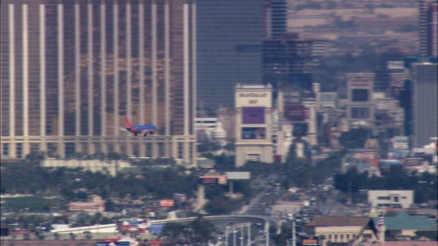 passenger jet coming into land  - aerial view - nevada,  clark county,  united states - clark county nevada stock videos & royalty-free footage