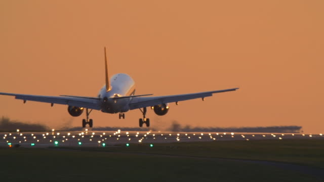 Passenger Jet landing evening. Slow motion.