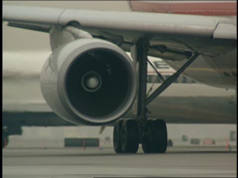 a passenger jet prepares for take off. - landefahrwerk stock-videos und b-roll-filmmaterial