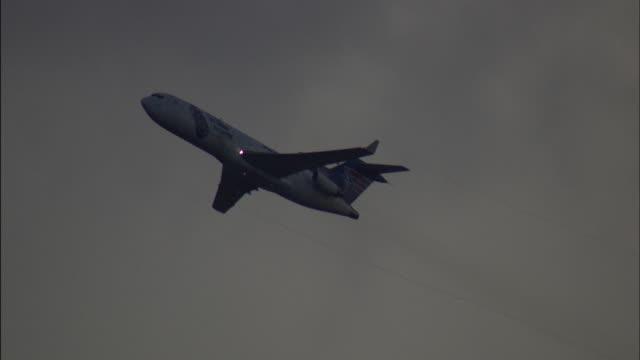 la ws pan passenger jet taking off - generic location stock videos & royalty-free footage