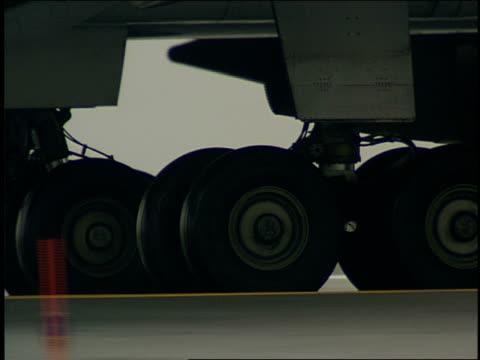 a passenger jet taxis along the runway. - landefahrwerk stock-videos und b-roll-filmmaterial