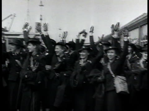 passenger ocean liner ship w/ soldiers standing at railing two levels. group of nurses in uniform waving. canadian soldiers walking down gang plank... - passenger ship stock videos & royalty-free footage