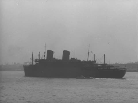 passenger ocean liner ss west point in leaving harbor . loading auxiliary ship in brooklyn navy yard men walking up/down gang plank crane moving... - 1941 stock-videos und b-roll-filmmaterial