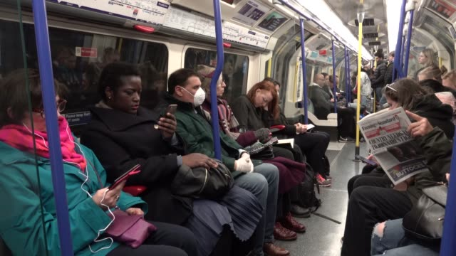 passenger on the london underground wears a surgical mask during the coronavirus pandemic in london on march 6, 2020 in london, england. - ロンドン地下鉄点の映像素材/bロール