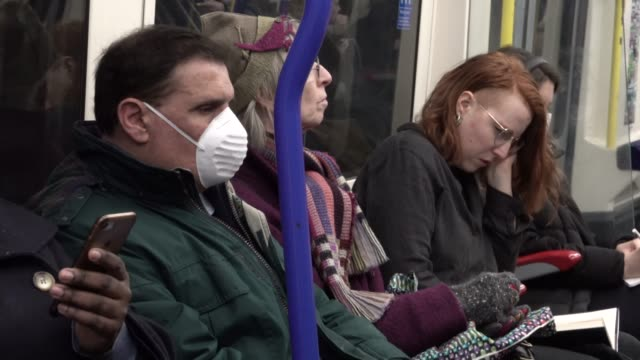 passenger on the london underground wears a surgical mask during the coronavirus pandemic in london on march 6, 2020 in london, england. - illness stock videos & royalty-free footage