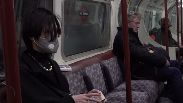 passenger on the london underground wears a surgical mask during the coronavirus pandemic in london on march 6 2020 in london england - pandemic illness stock videos & royalty-free footage
