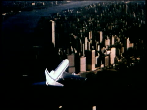 1976 aerial passenger plane approaches downtown manhattan and world trade center / new york city - 1976 stock videos and b-roll footage