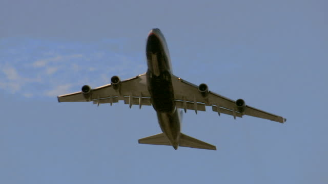 la ws passenger plane moving up into sky after taking off/ sydney, australia - low angle view stock-videos und b-roll-filmmaterial