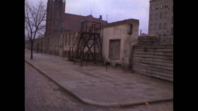 passenger point of view driving along the berlin wall with graffiti and steps on an urban road in berlin; 1969. - national landmark stock videos & royalty-free footage