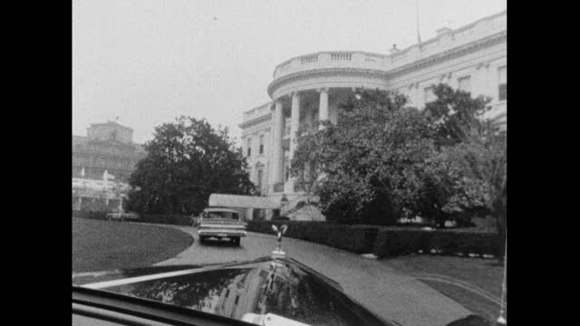 passenger point of view shot from the inside of a rolls royce car as it arrives at the front entrance of the white house in washington dc; 1964. - chauffeur stock videos & royalty-free footage