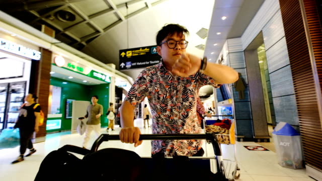 a passenger running to check-in counter in airport terminal with luggage cart after final call. worst holiday concept. - catching stock videos & royalty-free footage