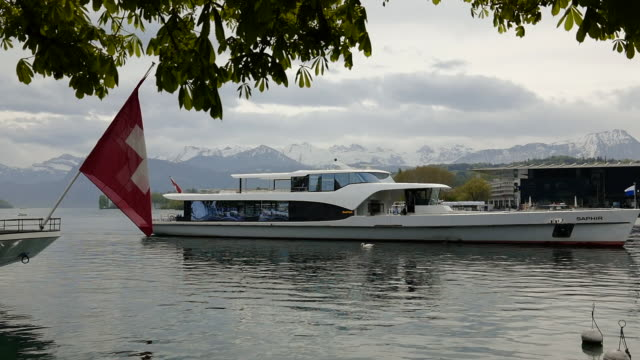passenger ship and kkl and culture and convention center lucerne and lake with snow-capped mountain in switzerland. - lake lucerne stock videos & royalty-free footage