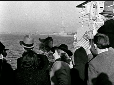passenger ship on ocean behind passengers on deck looking at statue of liberty tu statue of liberty ms people on deck smiling ms top of 'lady... - emigration and immigration stock videos & royalty-free footage