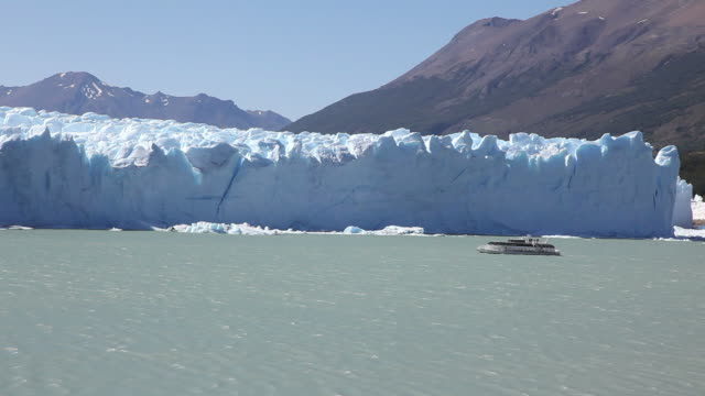 passenger ship passing by perito moreno glacier, patagonia, argentina - ice floe stock videos & royalty-free footage