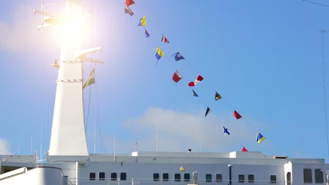 stockvideo's en b-roll-footage met passagiersschip met vlaggen - aangemeerd