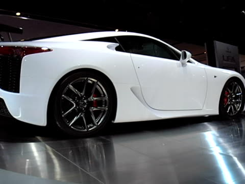 ws la passenger side profile and rear end of lexus lfa revolving on turntable / ms front seats interior / ws front left wheel and front fender / ws... - anamorphic stock videos and b-roll footage