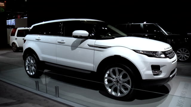 passenger side profile; evoque door emblem; to rear end of suv 2012 land rover range rover evoque montage at cobo hall on january 19, 2011 in... - land rover stock videos & royalty-free footage