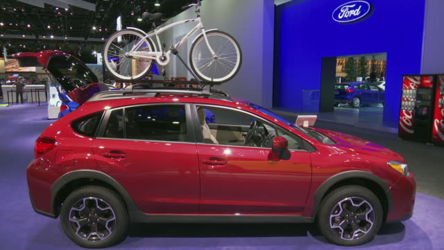 passenger side profile of crosstrek with bicycle mounted on roof / right side profile of bike / passenger side profile; subaru logo on bike frame /... - subaru stock videos & royalty-free footage
