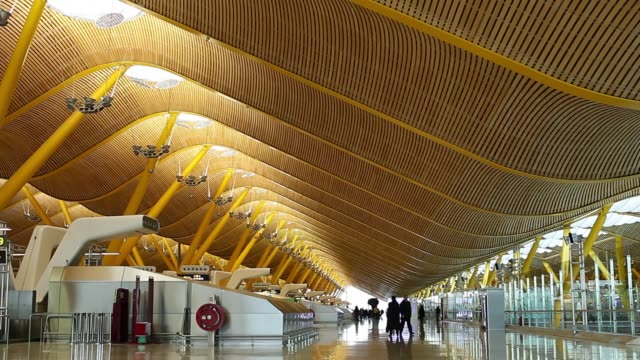 A passenger stands at an information desk inside a terminal building at Madrid Barajas airport operated by Aena SA in Madrid Spain on Wednesday Feb...