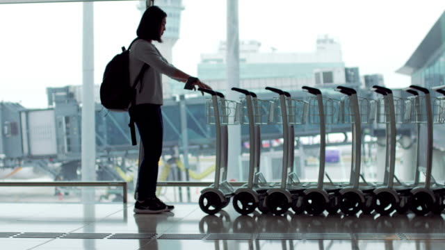 passenger take a cart in the terminal airport - luggage trolley stock videos & royalty-free footage