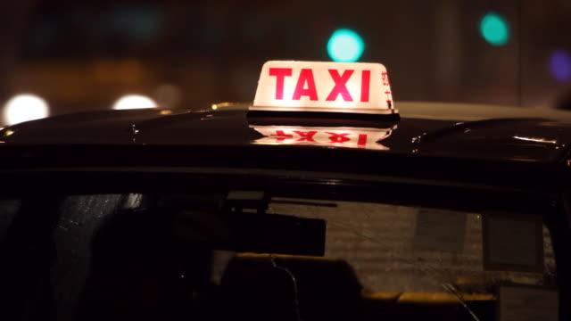 CU Passenger taxi at night / Hong Kong, China