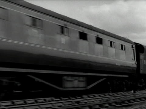 vidéos et rushes de passenger train and goods train pass each other on a section of railway. - wagon