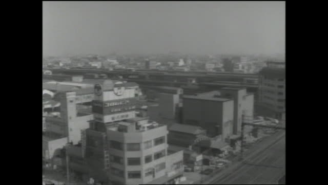 a passenger train approaches the akihabara railway station. - akihabara station stock videos and b-roll footage