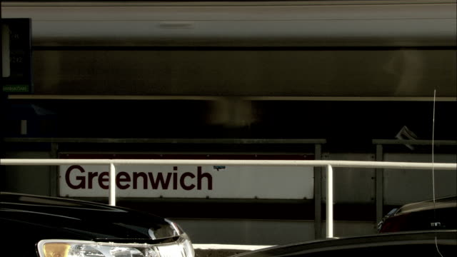 A passenger train arrives at Greenwich station. Available in HD.