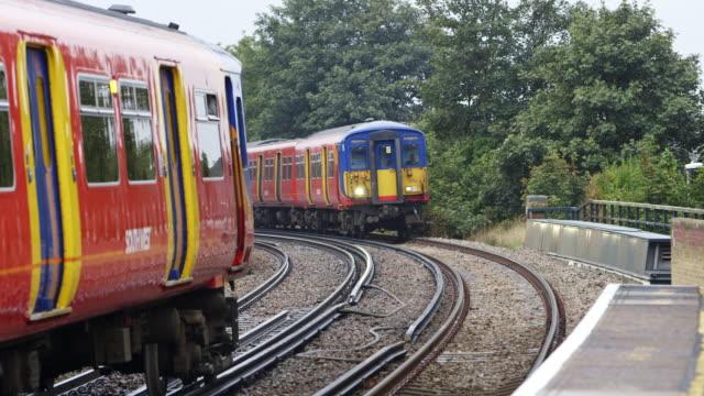 ms passenger train arriving to norbinton railway station / london, england, united kingdom - railway station stock videos & royalty-free footage