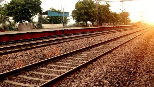 passenger train crossing station - railway track stock videos & royalty-free footage