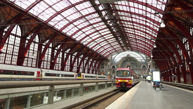 passenger train departing from antwerp central station - railway track stock videos & royalty-free footage