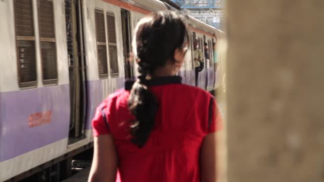 A passenger train departs a railway station in Mumbai.