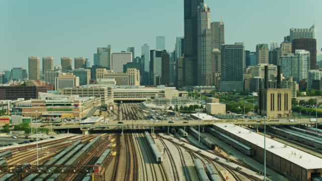 passenger train headed towards downtown chicago - willis tower stock videos & royalty-free footage