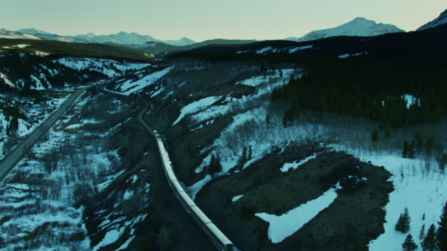 passenger train in montana in wintry twilight - aerial view - glacier national park us stock videos and b-roll footage