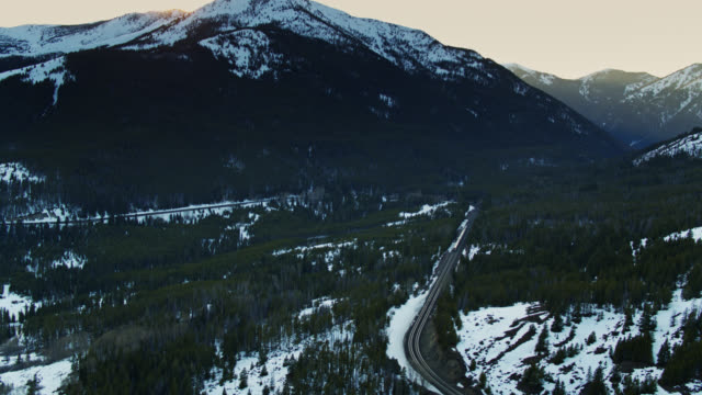 passenger train in montana mountain pass near glacier np - aerial - glacier national park us stock videos and b-roll footage