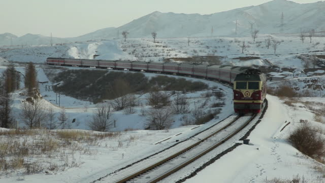 ws passenger train in snowy landscape / inner mongolia, china - independent mongolia stock videos and b-roll footage