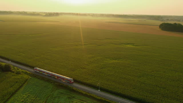 aerial passenger train in the countryside at sunset - 50 seconds or greater stock videos & royalty-free footage