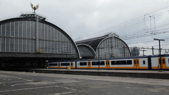 Passenger train leaving Amsterdam central station