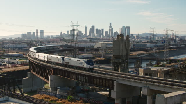 passenger train leaving los angeles - aerial shot - industrial district stock videos & royalty-free footage