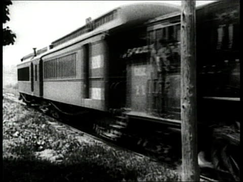 stockvideo's en b-roll-footage met passenger train moves down train tracks in a rural area. - stoomtrein