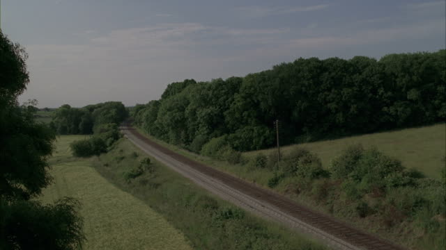 a passenger train moving on a railroad in the countryside. - 1 minute or greater stock videos & royalty-free footage