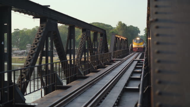 a passenger train on the railway bridge - railway bridge stock videos & royalty-free footage