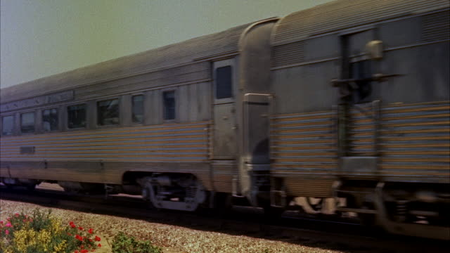 ms passenger train passes and exits small town train station building - railroad car stock videos and b-roll footage