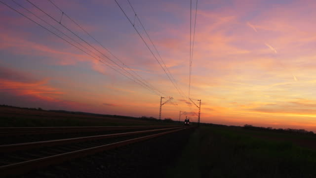 stockvideo's en b-roll-footage met passenger train passing by at dusk - geschwindigkeit