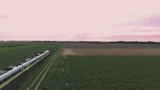 passenger train passing through countryside flyover - moving past stock videos & royalty-free footage