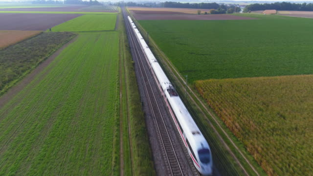 vídeos y material grabado en eventos de stock de passenger train passing through countryside in autumn - tramway