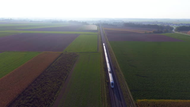 passenger train passing through countryside in the afternoon - rail transportation stock videos & royalty-free footage