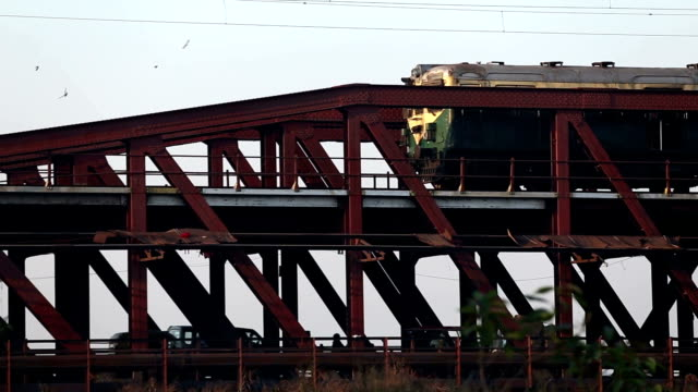 passenger train passing through iron bridge - railway bridge stock videos & royalty-free footage
