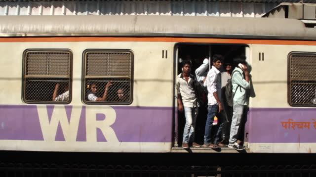 stockvideo's en b-roll-footage met a passenger train pulls away from a railway platform. - passenger train