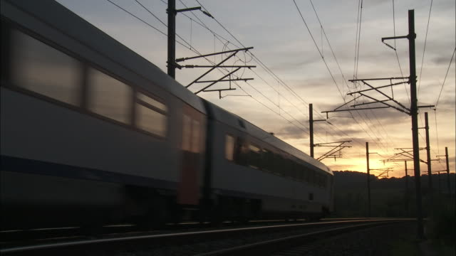 a passenger train races through the belgium countryside. - telegraph pole stock videos and b-roll footage